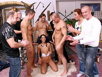 Marieke drops to her knees to give two guy a blow job