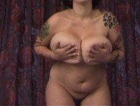 Horny tattooed big boob babe in silky leopard print chemise decides to get naked and play with her pussy