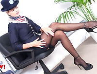 Attractive air hostess Victoria Summers stripteases from sexy pink satin lingerie and black stockings at the airport.