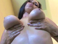 Darla from DevineOnes topless in the bathroom along with some lotion. Watch as she rubs lotion over her massive breasts using both hands! There is a great shot near the end of this preview video where the camera man gets low and shoots right up as she holds both of her breasts and squeezes! So HOT!