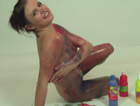 Tight teen Dani Scott decides to get messy in her latest video. Watch this horny British babe strip totally naked and pour paint over her little titties before rubbing it down her stomach and into her tight wet pussy. Dani loves getting messy and i'm sure you will love it too