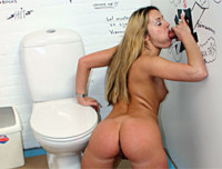 A blonde girl walks into a toilet and pulls her panties down to have a pee. Then a stiff dick appears through a hole in the wall. She gets a fright at first but then she sucks it and then shoves it up her pussy, fucking her eyeballs out.