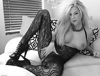 xoGisele wears a crotchless body suit and has some fun in front of the webcam