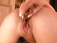 Daisy Dolce slides the dildo back and forth with her graceful French-manicured fingers