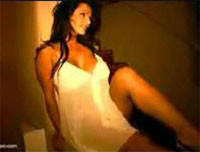 Denise Milani walking in white lingerie