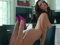 Carlotta Champagne naked on a chair