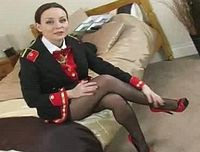 Naughty usherette teases her way out of the uniform.