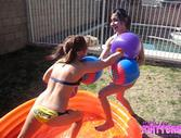 Two bikini teens in a boxing match