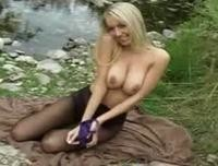 Beautiful blonde Hayley Marie seductively removes miniskirt and purple top.