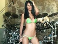 Sexy latina Karla Spice rocks out on the drums and strips