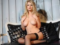 Jess Davies in pink lingerie and black stockings