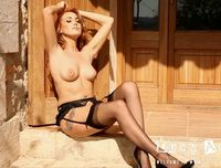 Lucy Anne strips from her black lingerie